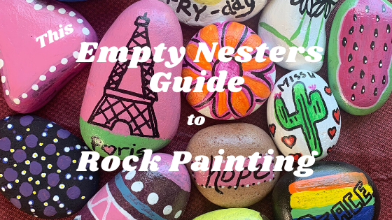 This Empty Nesters Guide to Rock Painting Text over photo of painted rocks Eiffel towers, cactus, watermelon, flower, rainbow