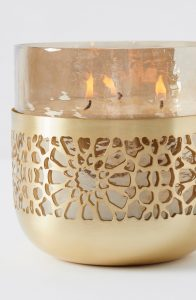 Anthropologie grapefruit candle in gold textured holder